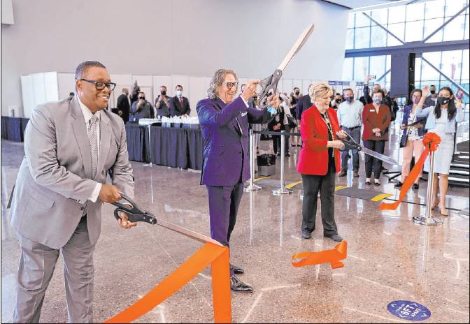 Councilman Cedric Crear, left, International Market Centers CEO Bob Maricich and Mayor Carolyn Goodman participate in a ribbon-cutting for the Expo at World Market Center on Friday in downtown Las Vegas.